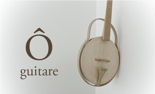 Visuel du projet Ô : une guitare en bois tourné