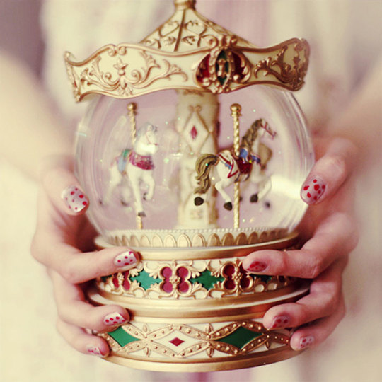 Kitty-gallanaugh-photography-vintage-globe-carousel-hands-girl-woman-1409214866