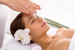 Getting-reiki-therapy-peaceful-girl-47070316-1434802304