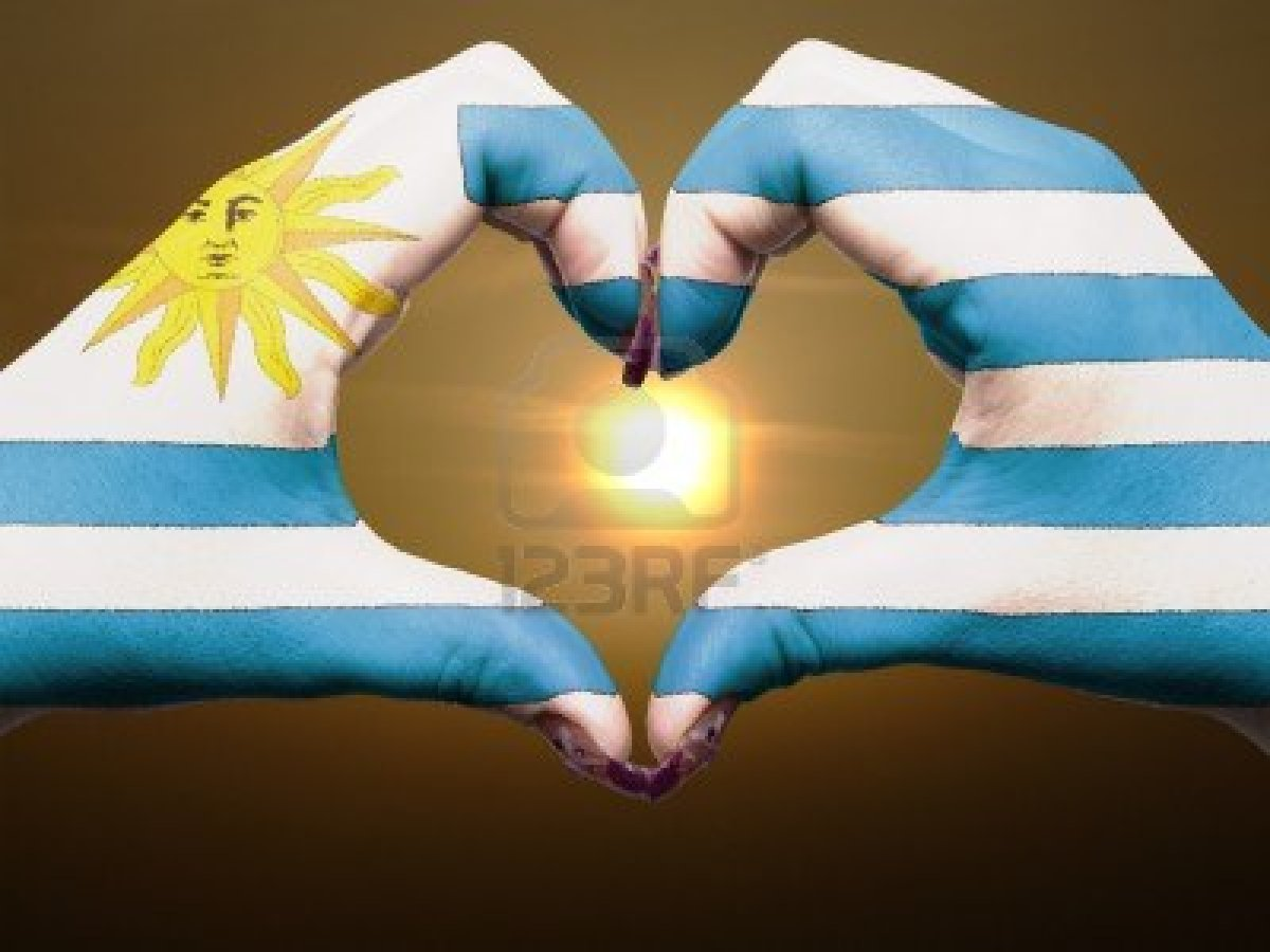 12981541-tourist-uruguay-made-by-america-flag-colored-hands-showing-symbol-of-heart-and-love-during-sunrise.jpg