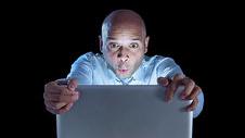 businessman-alone-at-night-sitting-at-computer-laptop-watching-porn-or-online-gambling_bwc22752530-1515507118.jpg