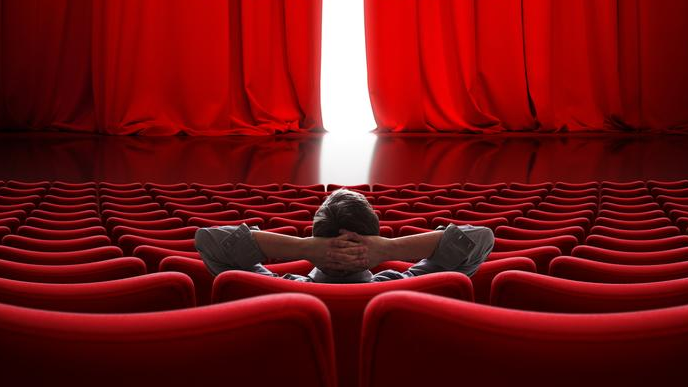 vip-sitting-front-slightly-open-movie-theater-red-curtain-bright-light-behind-vip-sitting-front-slightly-open-109172572-1523051157.jpg